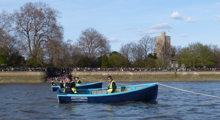 The stake boats at the start.
