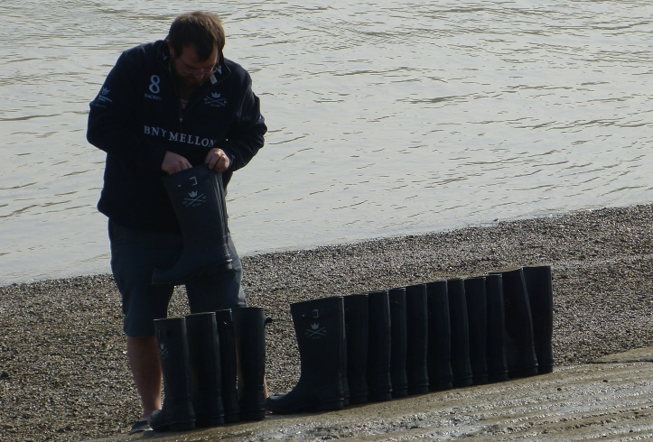 The Oxford boatman arranges the boots belonging to Isis (Oxford men's reserves) in crew order, ready for their return from their outing. I suggested that he put 'L' or 'R' on them as well.