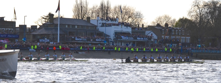 Both crews passing Thames Rowing Club. As is common with rowing pictures, the parallax error makes the difference between the crews appear greater than it was. Also, rowing pictures tend to be 'long and narrow', so click on them to view properly in full screen.