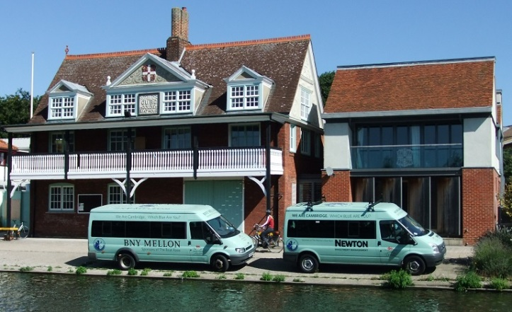 Goldie Boathouse in 2013 with minibuses sponsored by Mellon and Newton.
