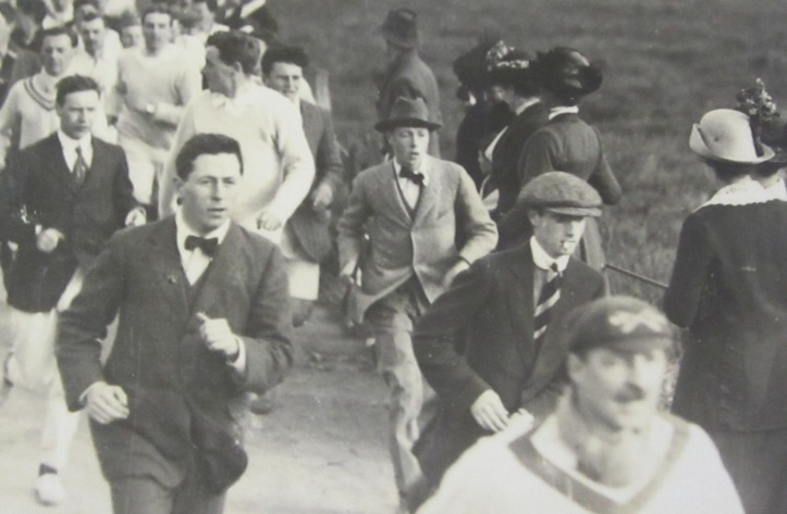 Oxford students following a race during Eights Week, 1913. Picture reproduced by kind permission of Magdalen College.