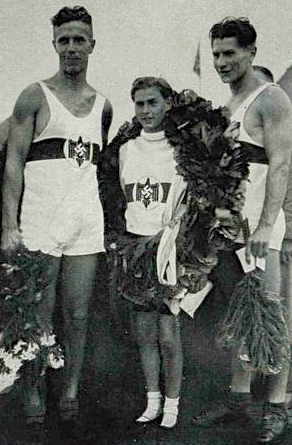 The victorious German coxed pair, Gerhard Gustmann, Herbert Adamski and cox, Dieter Arend.