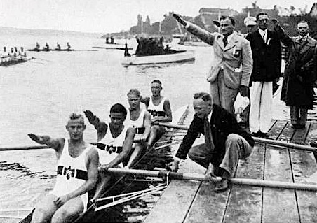 The German coxless four give the Nazi salute.