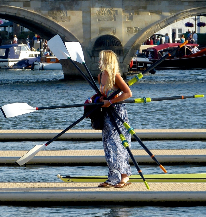 Pic 13. One of Stanford's little helpers puts their sculls away after the lost to Molesey in the semi of the Princess Grace.