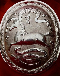 Pic 1. Part of the prize for winning the Doggett's Coat and Badge sculling race, a silver arm badge. It shows the running white horse, the symbol of King George I's House of Hanover, and the inscriptions 'Liberty' and 'The gift of Thomas Doggett, the late famous comedian' – plus the name of the winner of that particular badge. Doggett instigated the race in 1715 in celebration of George's ascension to the throne and the securing of a Protestant line of succession.