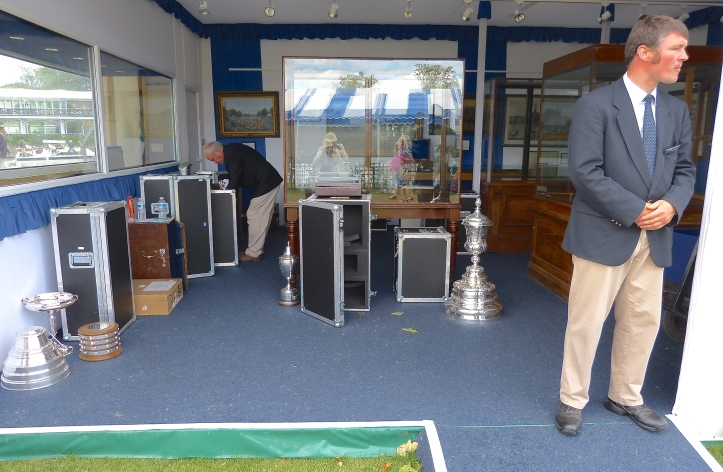 Pic 18. After the prize-giving the trophies are put back into their flight cases, presumably on their way to a silver specialist to be cleaned of fingerprints, lip marks, Champagne, sweat and tears, all to be ready for the 2016 Henley Royal Regatta.