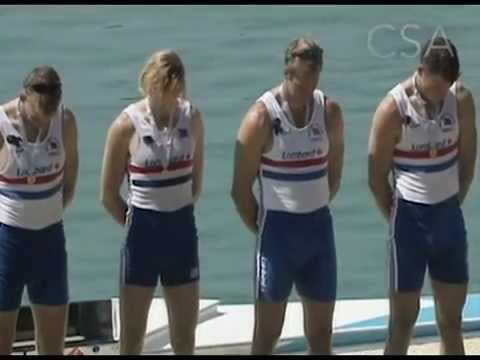 James Cracknell, Steve Redgrave, Tim Foster and Matt Pinsent with bowed heads on the podium.