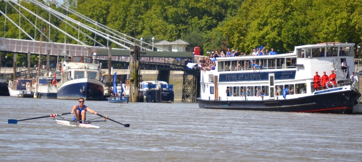 Pic 19. Pettipher pictured a few strokes away from the finish line (which is marked by the small blue rowing boat with the blue flags).
