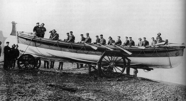 Pic 6. The 16-oared Sheringham Lifeboat, JC Madge https://en.wikipedia.org/wiki/RNLB_J_C_Madge_(ON_536) pictured in 1904. She was in use from 1904 until 1936 and was non-self-righting which, paradoxically, many lifeboatmen preferred as they were more stable than self-righting boats.