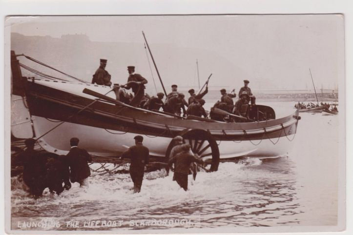 Pic 8a. The launch of the Scarborough lifeboat using man power.