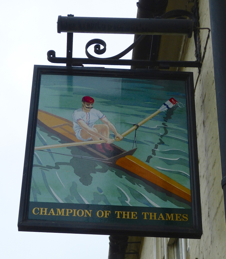 Pic 13. The pub sign for the Champion of the Thames. Whoever the 'Champion' was, this picture incorrectly shows a 'gentleman amateur' and not a working class, professional waterman. He also needs to sort out his peculiar riggers.