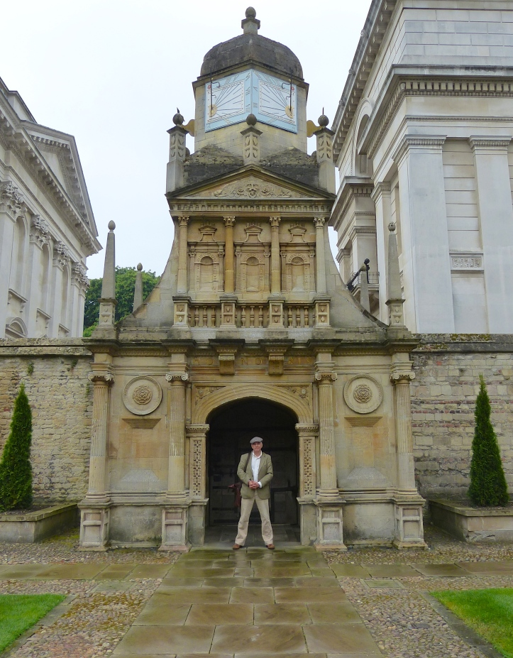 Pic 4. Tim at the 'Gate of Honour' in Caius Court, built c.1565. The college's three gates symbolise the path of academic life. The student arrives at the Gate of Humility, in the centre of the college, they regularly passes through the Gate of Virtue and finally, the graduands pass through the Gate of Honour on their way to the Senate House to receive their degrees. Only Fellows https://en.wikipedia.org/wiki/Fellow of the college can routinely use the Honour gate – or walk on the grass in the quad.