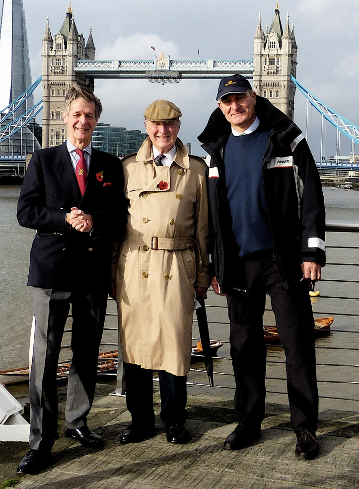 Pic 4. Malcolm Knight (on the right) at a previous event that he was involved with, the river procession for the 2014 Lord Mayor's Show. He has, as he says, 'a flair for organising rowing events'. On the left is Peter Warwick, Chairman of Thames Alive and in the centre is Lord Stirling, who initiated the project to build the Queen's Row Barge, Gloriana.