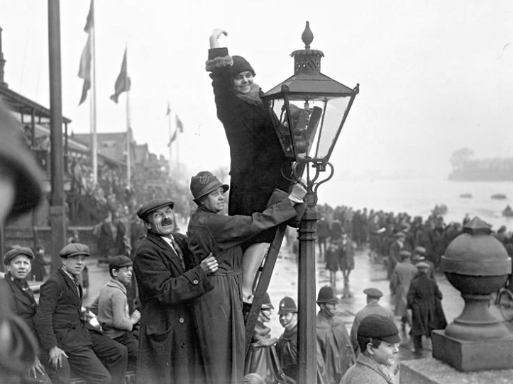 Pic 2. 'Don't bother coming down – another race will be along in a minute'. Actually these are Boat Race supporters on Putney Embankment in 1928 – when there was only one race to watch and the police were not concerned with health and safety.