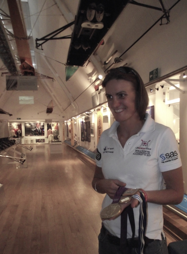Pic 3a. Heather shows some hard earned 'bling' – Olympic, World and European gold medals.
