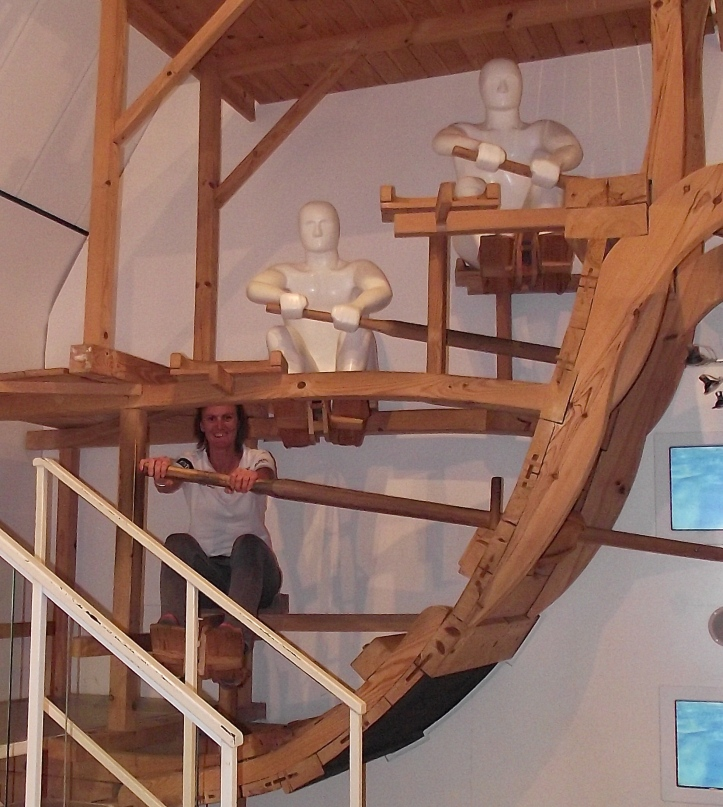 Pic 4. Heather on the RRM's mock up of part of a trireme. https://en.wikipedia.org/wiki/Trireme I am glad to see that, unlike the other two, she has her outside hand on the end of the handle.