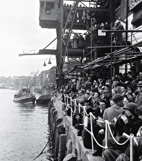 Pic 6. Bemax employees gather outside their factory on Boat Race Day 1948, waiting for the big race to pass.