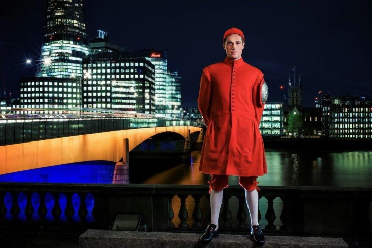 Pic 1. Louis Pettipher, the 2015 winner of the Doggett's Coat and Badge, the 300-year-old sculling race for young watermen run from London Bridge to Chelsea, standing on the terrace of Fishmongers' Hall with London Bridge in the background. Picture from @TidewayLondon.