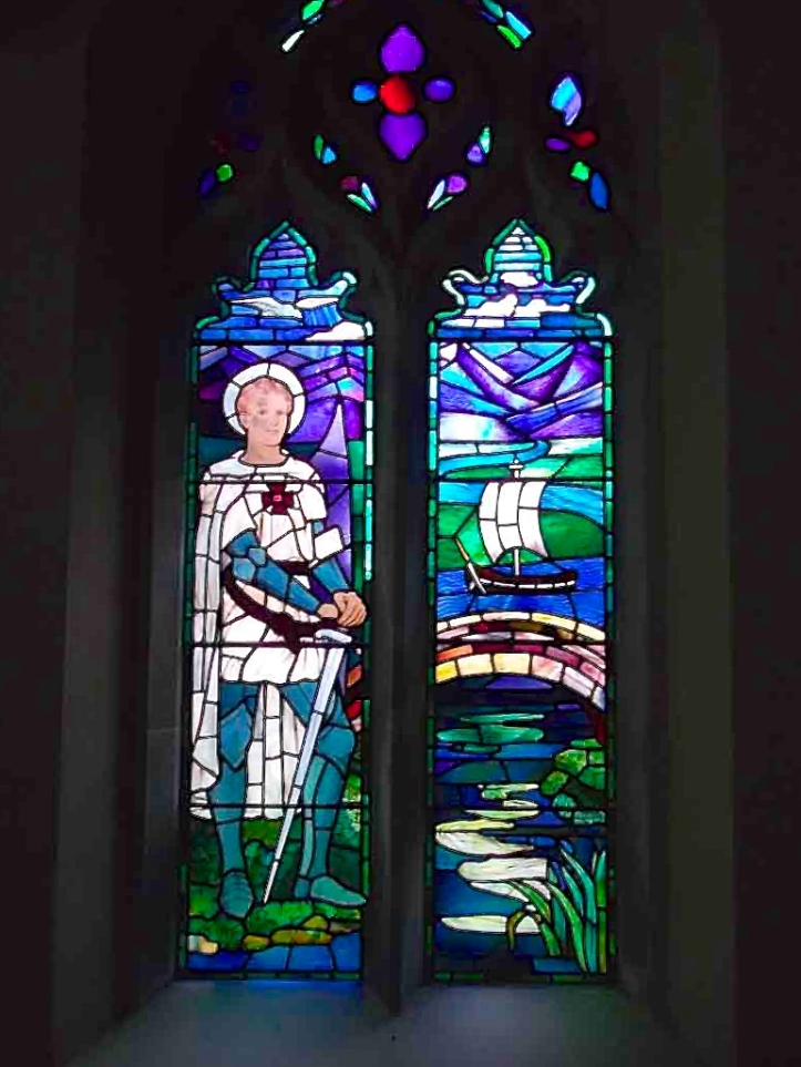 Pic 10. In 1923, Julian Gribble's sister, Vivien, designed this stained glass window in St. Martin's Church, Preston, Hertfordshire, depicting her brother's face on a representation of St Martin. The Saint has what appears to be a Victoria Cross on his chest.