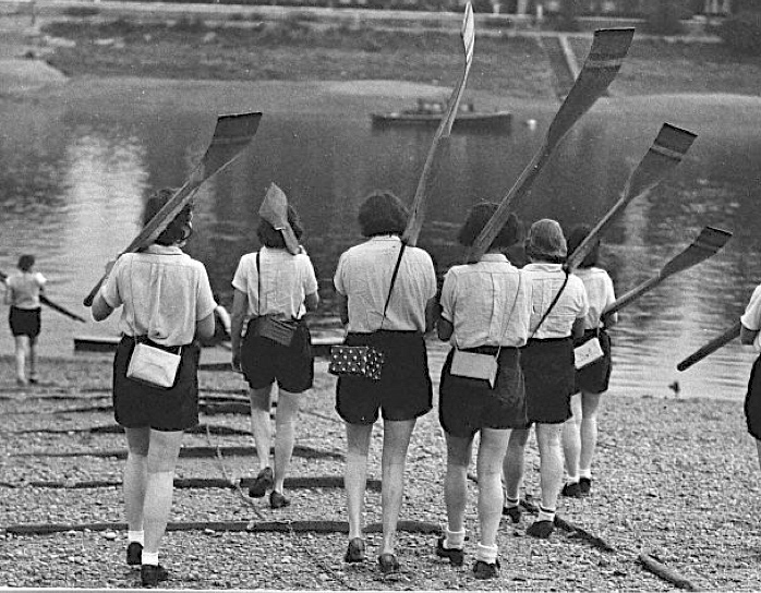 Pic 6. Women about to go rowing from Tom Green's during the 1939-1945 War. They are carrying gas masks in individually decorated cases.
