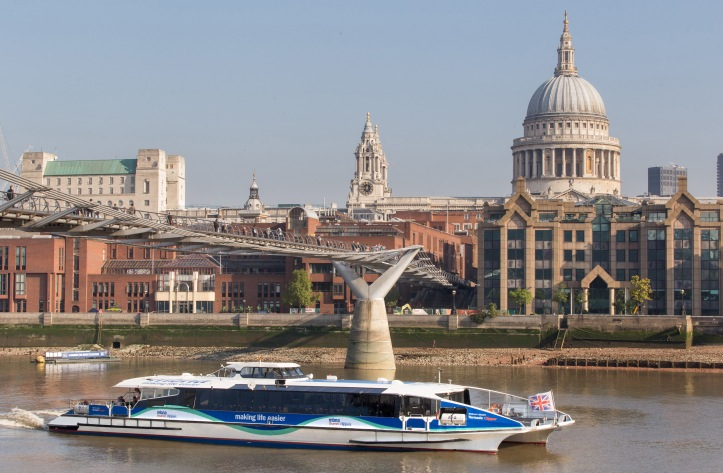 Pic 7 Carrying commuters at each end of the day and tourists in the middle, the Thames Clipper 'Tornado' passes under the Millennium Footbridge of 2000, one of the many impressive new structures to be built on the 'rediscovered' Thames in recent times.