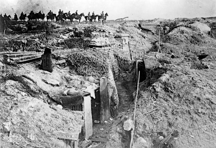 Pic 8. German troops pass an overrun British position during the initially successful phase of their 1918 Spring Offensive, largely an attempt to capture the Channel Ports before the Americans could effectively enter the war. 3455/18