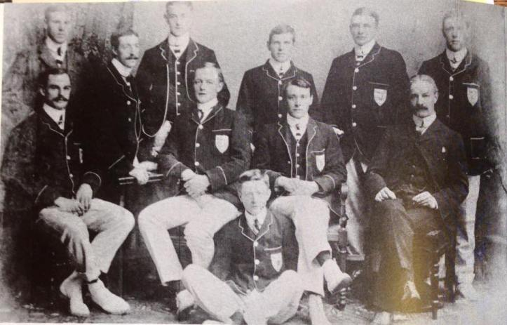 The 1903 TCD senior eight, winners of the Thames Cup at Henley Royal Regatta. Back row: (L to R) E.L. Julian (coach), H.B. Mayne (6), W.F. Fox (bow), J. Cunningham (2), M.P. Leahy (3), J. du P. Langrishe (7). Front row: A.A. McNeight (4), H.A. Emerson (5), E.B. Bate (cox, in front), F.J. Usher (stk.), R.C. Lehmann (coach).