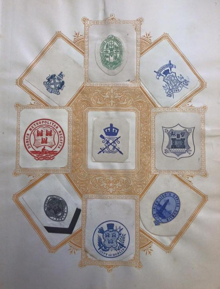 Nine Dublin Crests: Duke of Leinster, Royal College of Surgeons in Ireland, Pembroke Rowing Club. Dublin Metropolitan Regatta, Lord Mayor of Dublin, Dublin University Bi (?) Club. Trinity College Dublin, Lord Mayor of Dublin, Commissioners of Irish Lights (Dublin Office).