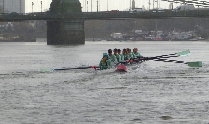 Pic 3b. Approaching Hammersmith Bridge both crews were close to Surrey and the Tideway cox, Olivia Godwin, struck a navigation buoy, something which must have further unsettled her already pressured crew.