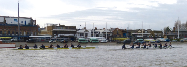Pic 8. The yellow boat on the Surrey side was stroked by Maddy Badcott and was given the name 'Charybdis'. The white boat on Middlesex was called 'Scylla' and the stroke was Emma Lukasiewiez. The names on the two boats came from a Greek phrase meaning 'having to choose between two evils' (something that I intend to drop into conversation in the future). Pictured here passing London Rowing Club, Scylla took an early lead.