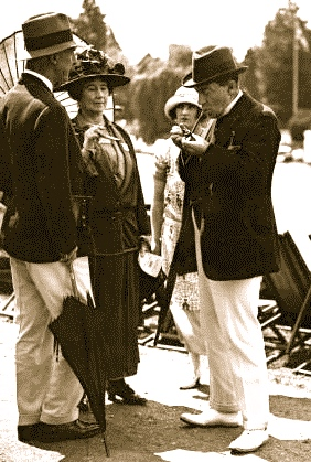 Pic 2. Conservative Party leader Stanley Baldwin (with pipe) who was Prime Minister three times between 1923 and 1937 (alternating with twice Prime Minister, Ramsay MacDonald) at the 1924 Henley Royal Regatta, an event that he attended regularly. http://www.britishpathe.com/video/henley-regatta-1 He also gave Stourport Regatta, which was in his constituency, the Stanley Baldwin Cup for coxed fours. Baldwin is relatively little remembered, perhaps due to his self-effacing character. One apocryphal story has Prime Minister Baldwin meeting someone that he was a school with who and asked him what he was doing now.