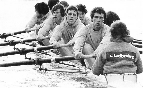 Pic 1. When Hugh Laurie (and seven others) rowed for Cambridge in 1980, it was the fourth time that the race had been sponsored. This picture must have taken during training as, until 2012, the sponsor's name or logo (in this case Ladbrokes) was not displayed on kit or equipment during the race itself.