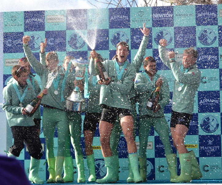 Finally, it was Cambridge to could spray the champagne after the race. Photo: Tim Koch.