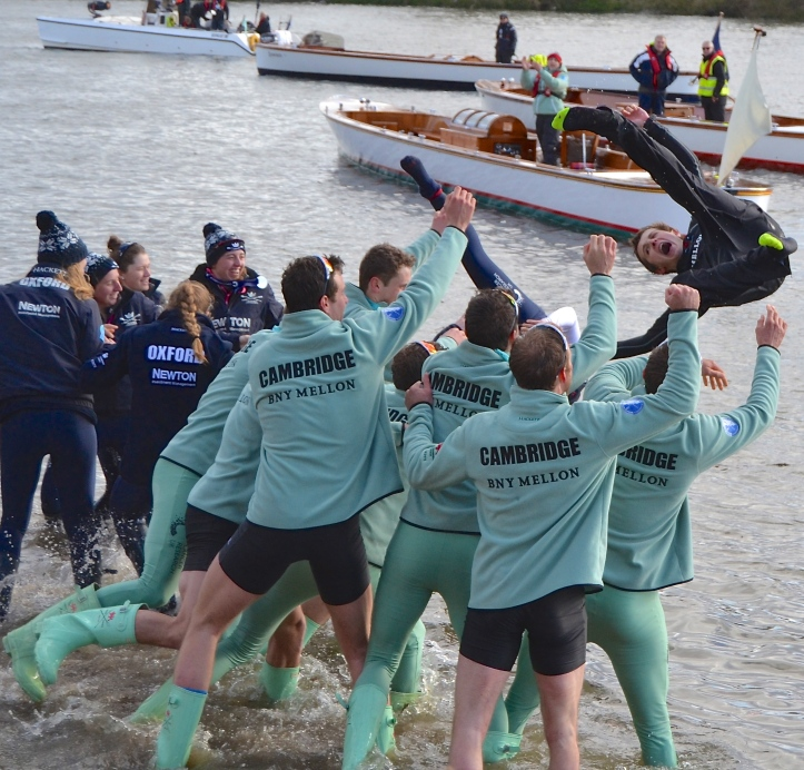 A new tradition: Oxford's winning women tossed in their cox, Morgan Baynam-Williams, at the same time as Cambridge men tossed in their cox, Ian Middleton. Photo: Tim Koch.