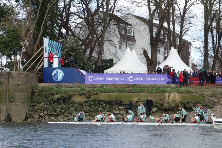 Cambridge women arriving in Mortlake.