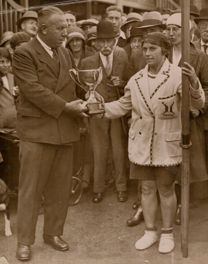 Pic 4. Amy receiving a trophy for winning the 1932 Woman's Sculling Championship from the famous coach and boatbuilder, 'Bossie' Phelps.