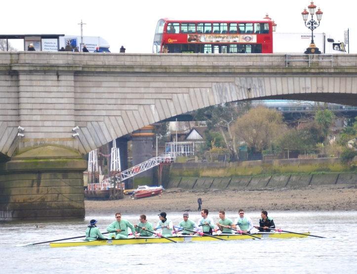 Pic 5. It is compulsory to wait for a London Bus to pass overhead before taking a picture of a crew under a bridge – Putney Bridge and a number 93 in this case.