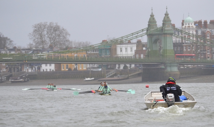 Pic 6. The Cambridge Men's Blue Boat, in the foreground, and Blondie, in the background, pass under Hammersmith Bridge.