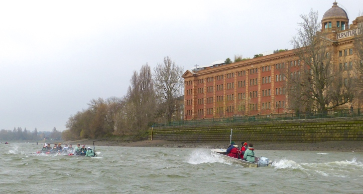Pic 8. Passing Harrods, CUWBC Coach Rob Baker follows his girls into the headwind.