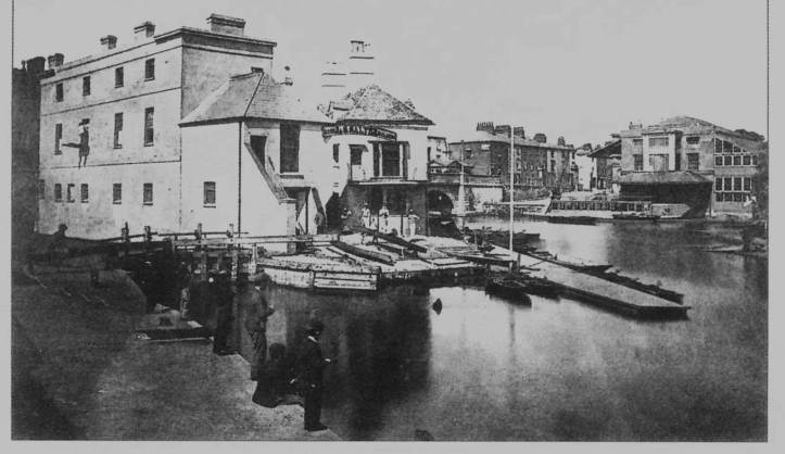 The gated pound lock (left) with Salter's buildings on Folly Island behind and to the right of it, c.1873. Salter's warehouse, now the Head of the River pub, is on the far right. Image © Salter's Steamers.