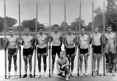 The heroes in the boat: (from left) Stroke Donald 'Don' Hume, 7 Joseph 'Joe' Rantz, 6 George 'Shorty' Hunt, 5 Jim 'Stub' McMillin, 4 John 'Johnny' White, 3 Gordon 'Gordy' Adam, 2 Charles 'Chuck' Day, Bow Roger Morris and, kneeling, Cox Robert 'Bobby' Moch.