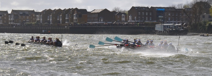 Pic 12. + 11 min 28 sec: By this stage it was clear that Cambridge had taken on a lot of water and that Oxford had better adapted to the extreme conditions. The times to Chiswick Steps were Oxford 12 min 39 sec, Cambridge 12 min 47 sec. Psalm 69:14. Deliver me from the mire and do not let me sink; May I be delivered from my foes and from the deep waters.