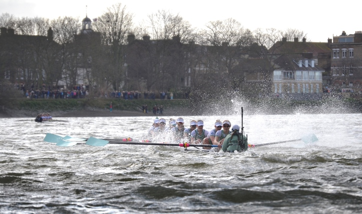 Pic 17. + 18 min 42 sec: Above Barnes Bridge, Cambridge were clearly in serious trouble with their hull barely visible, but modern rules on buoyancy mean that the swamped boat was just about rowable. James 1:12 Blessed is the one who perseveres under trial…..