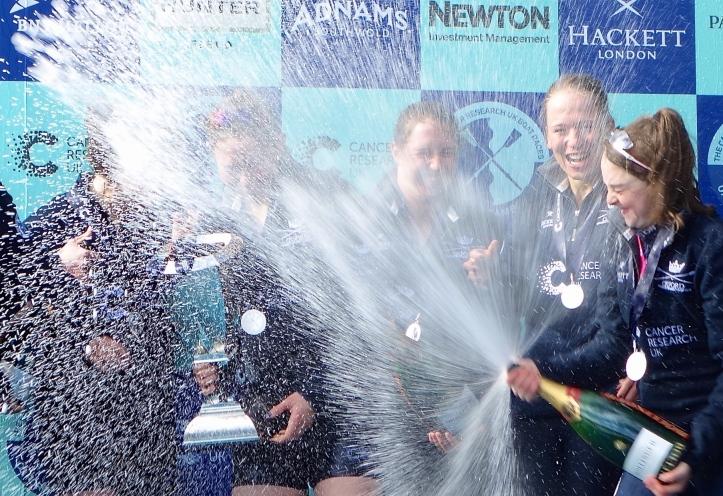 Pic 23. Cox Morgan Baynham-Williams sprays 'grand cru' over her grand crew. Picture: Hélène Rémond.