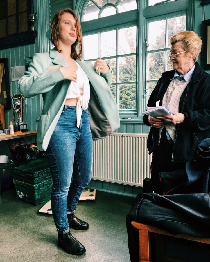 Picture 4: Neria Aylward, Canadian native and second year social sciences student, Pembroke College BC W1's four-seat for Lent Bumps, tries on a blazer of aspirational design. Photo: CL, with an iPhone 6 and VSCO.
