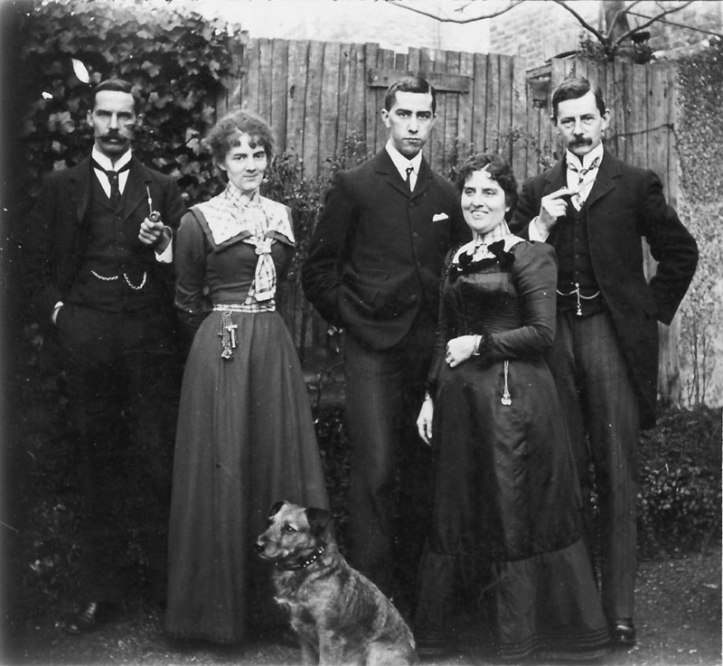 Reginald Bray with family members and the dog he mailed. Courtesy of John Tingey.