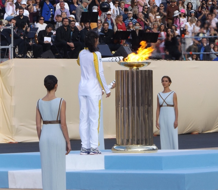 Pic 3. Nikolaidou lights the cauldron in the centre of the Panathenaic Stadium. The flame was then handed over to representatives of Rio 2016. Picture: Philip Barker.