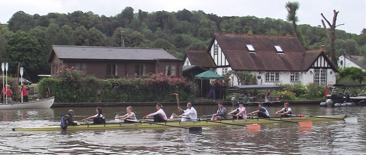 Pic 5. Steve Redgrave carries the torch at Henley as part of the 2012 Relay. He was accompanied by young members of the three Henley rowing clubs.