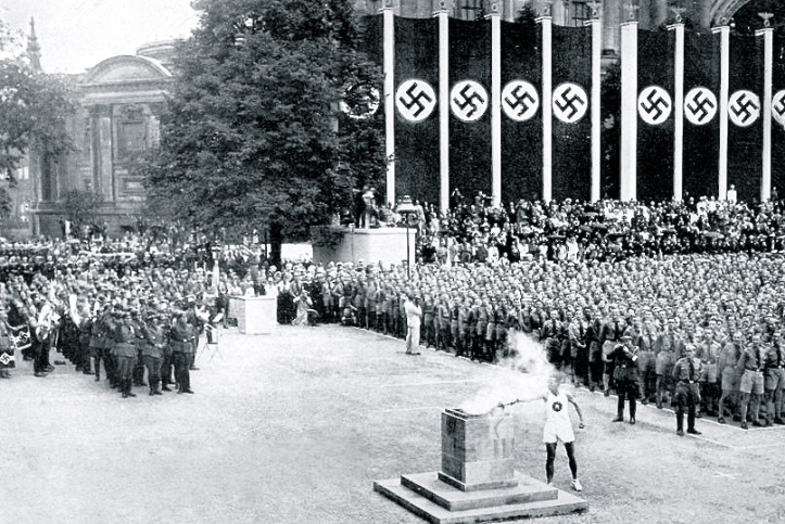 Pic 6. The 1936 Berlin Olympics. Siegfried Eifrig, a tall, blond, blue eyed German sprinter, carried the Olympic flame into the centre of Berlin where he lit two urns that burned throughout the Games.
