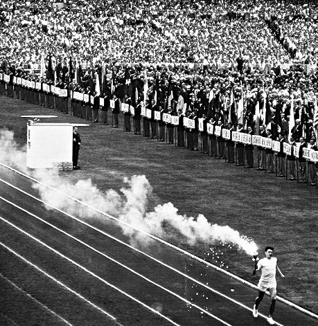 Pic 8. Still with the 1956 Games, the final relay runner has a real torch – but by the time that he lit the Olympic cauldron, he probably wished that he had carried some burning underwear on a bit of broken furniture.